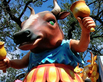 Rex float portraying a cow ringing bells. New Orleans
